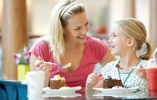 Mother and daughter enjoying cake together